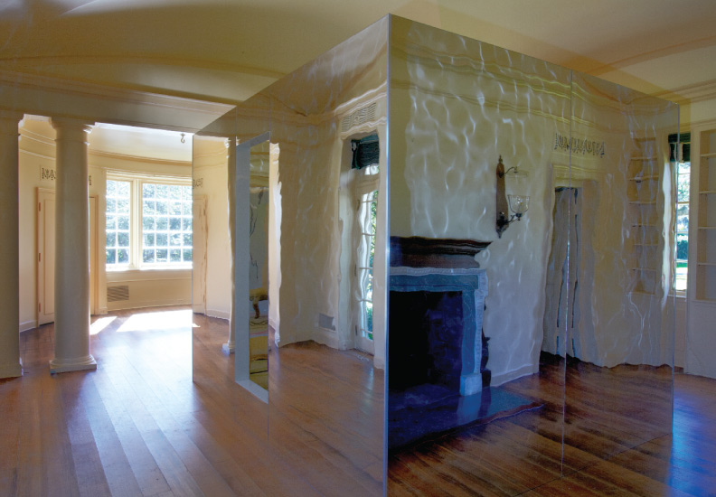 The Cube - located in the Whim House at Longue Vue House and Gardens, New Orleans. A mirrored box containing a room within a room. The exterior reflects the existing architecture and almost appears invisible.