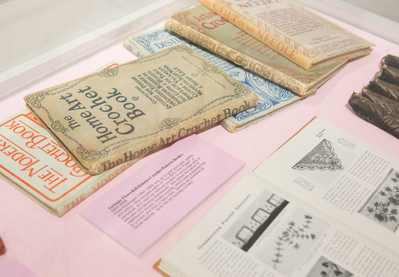 Curated and designed exhibition - Acquired Objects: textiles, tools and notions. The Judith Solomon Collection. October 10 - January 4, 2015. Cases and labeling were done in pink.